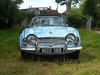 BNPS.co.uk (01202 558833)<br /> Pic: H&H Classics/BNPS<br /> <br /> A pensioner who has sold beloved classic car due to his failing eyesight is spending the proceeds on laser treatment to restore his vision so he can drive again.<br /> <br /> Derrick Schofield bought the Triumph TR4 brand new in 1962 because it could fit his large baritone saxophone in the boot.<br /> <br /> The musician and self-confessed ladies' man said the convertible motor used to impress the girls so much that he nicknamed it the 'Crumpet Catcher'.<br /> <br /> After six decades of happy motoring in it the 87-year-old has had to sell his pride and joy as he can no longer drive due to his poor eyesight.<br /> <br /> The Triumph went under the hammer for £16,000 and Derrick said he will use the money on medial treatment to see again.