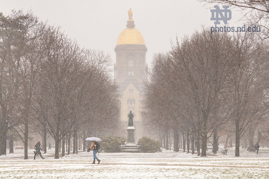 February 12, 2019; Students walk to class during a snow shower. (Photo by Barbara Johnston/University of Notre Dame)
