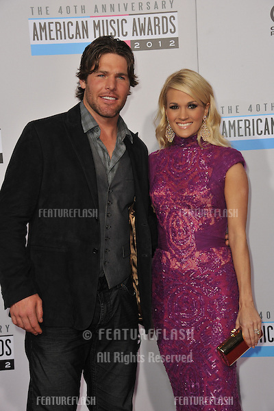 Carrie Underwood & husband Mike Fisher at the 40th Anniversary American Music Awards at the Nokia Theatre LA Live..November 18, 2012  Los Angeles, CA.Picture: Paul Smith / Featureflash