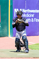 Quad Cities River Bandits catcher Ruben Castro (10) warms up in the bullpen prior to a Midwest League game against the Kane County Cougars on July 1, 2018 at Northwestern Medicine Field in Geneva, Illinois. Quad Cities defeated Kane County 3-2. (Brad Krause/Four Seam Images)