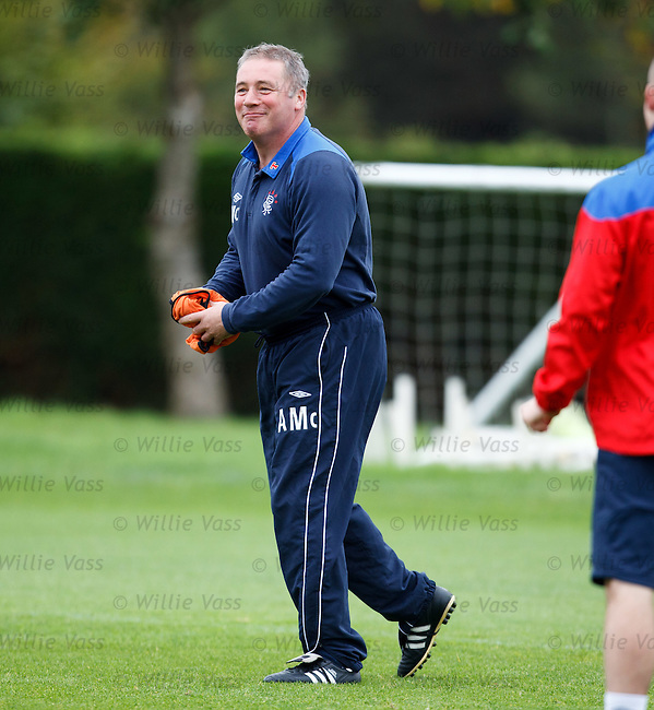 Ally McCoist at training looking pleased as he mixes it with the players