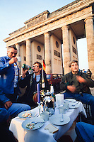 October 4, 1990. Berlin, Germany. In the morning after the reunification ceremony, Germans are having a champagne breakfast next to Brandenburg Gate. (Photo Heimo Aga)