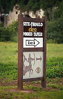 Sign to troglodyte caves grottos and pommes tapes, smacked apples, a local speciality, Saumur, Loire, France