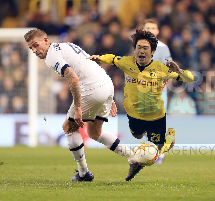 Tottenham's Toby Alderweireld tussles with Dortmund's Shinji Kagawa during the Europa League match at White Hart Lane Stadium.  Photo credit should read: David Klein/Sportimage