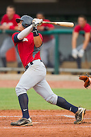 Christian Lopes #14 of Team Red follows through on his swing against Team Blue during the USA Baseball 18U National Team Trials at the USA Baseball National Training Center on June 30, 2010, in Cary, North Carolina.  Photo by Brian Westerholt / Four Seam Images