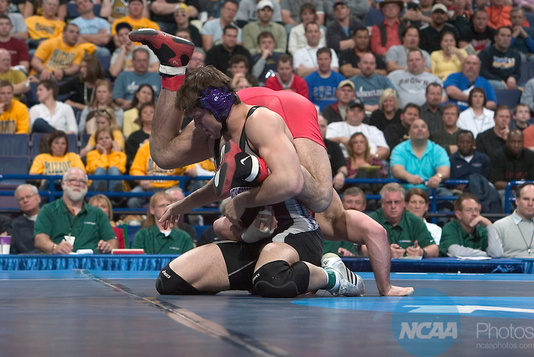 21 MARCH 2009;   Jake Herbert (in black) of Northwestern University wrestles with Mike Pucillo (in red) of Ohio State University during their 184 pound championship match at the 2009 NCAA Division 1 Men's Wrestling Championships Scottrade Center in St. Louis, MO. Herbert defeated Pucillo 6-3 to win the 184 pound national title.   Mark Buckner/NCAA Photos