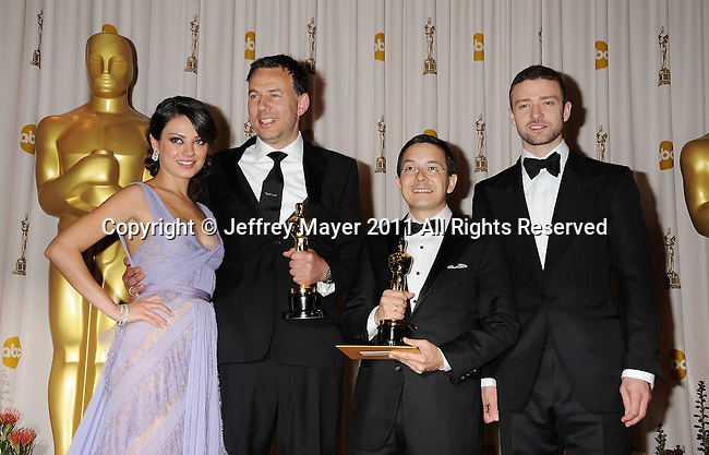 HOLLYWOOD, CA - FEBRUARY 27: Mila Kunis, Andrew Ruhemann, Shaun Tan and Justin Timberlake pose in the press room during the 83rd Annual Academy Awards held at the Kodak Theatre on February 27, 2011 in Hollywood, California.