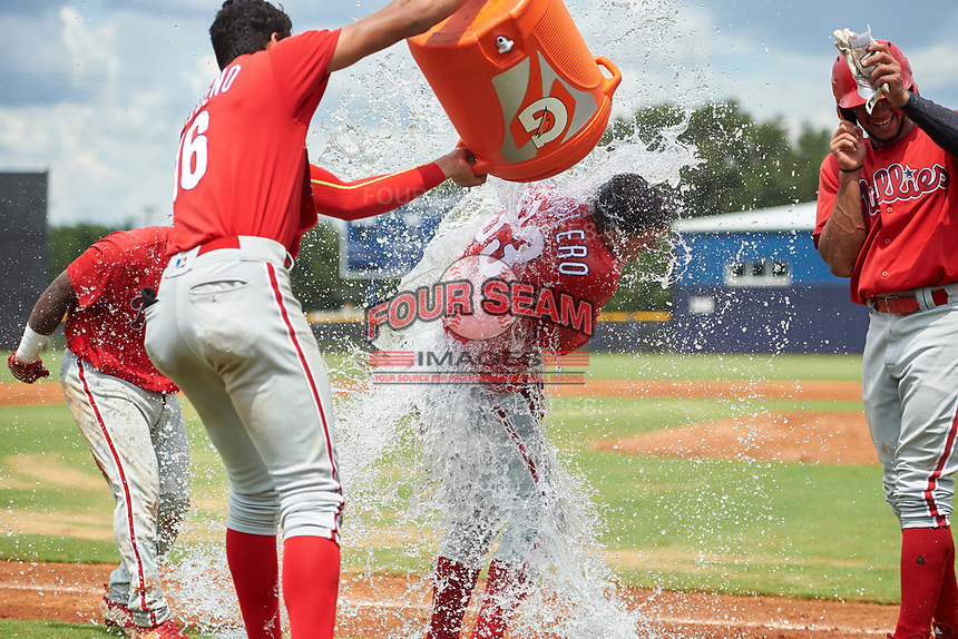 GCL Phillies East Jose Cedeno (16) dumps the Gatorade bucket full of water over Jose Tortolero after a walk-off sacrifice fly during a Gulf Coast League game against the GCL Yankees East on July 31, 2019 at Yankees Minor League Complex in Tampa, Florida.  Luis Matos is to the right.   GCL Phillies East defeated the GCL Yankees East 4-3 in the second game of a doubleheader.  (Mike Janes/Four Seam Images)