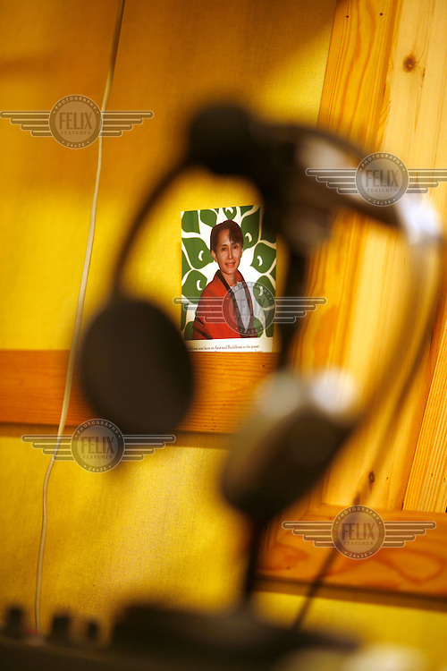 Picture of of Aung San Suu Kyi, on wall in radio studio.  Democratic Voice of Burma is radio and TV station run by exiled Burmese. Opposing the government, the DVB has been transmitting, from the Norwegian capitol Oslo, into Burma since 1992.