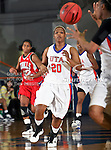 Texas - Arlington Mavericks guard Tamara Simmons (20) passes the ball in the game between the UTA Mavericks and the  Nicholls State University Colonels  held at the University of Texas in Arlington's Texas Hall in Arlington, Texas. UTA defeats Nicholls 69 to 62
