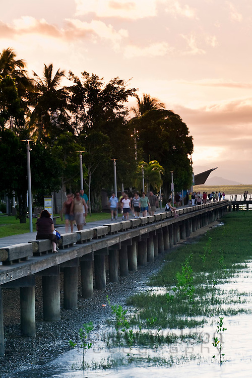 View along the Esplanade boardwalk at dusk.  Cairns, Queensland, Australia