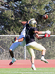 Palos Verdes, CA 10/27/17 - Eric Marshall (Morningside #4) and Jacob Hangartner (Peninsula #11)in action during the Morningside Monarchs - Palos Verdes Peninsula Varsity football game at Peninsula High School.