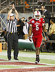 Louisville Cardinals quarterback Teddy Bridgewater (5) walks off the field after being sacked for a safety on his first possession of the game as the Louisville Cardinals played the Miami Hurricanes in the Russell Athletic Bowl in Orlando, Fl. on December 28, 2013.  Photo by Mark Mahan