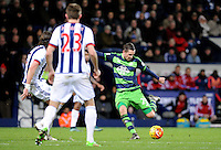 Gylfi Sigurdsson of Swansea City shoots at goal during the Barclays Premier League match between West Bromwich Albion and Swansea City at The Hawthorns on the 2nd of February 2016