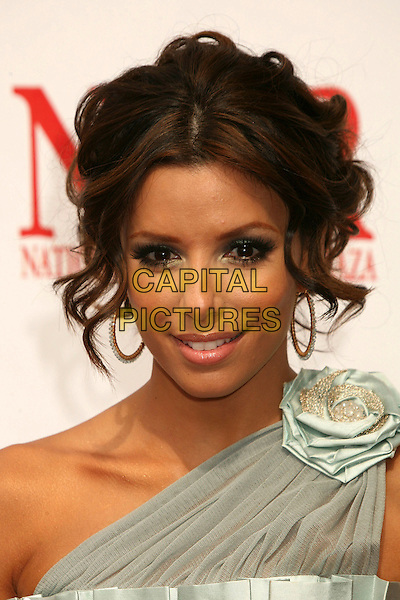 EVA LONGORIA.2007 NCLR ALMA Awards at the Pasadena Civic Center, Pasadena, California, USA, 1 June 2007..portrait headshot hoop earrings flower corsage on shoulder.CAP/ADM/BP.©Byron Purvis/AdMedia/Capital Pictures.