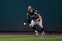 Barrett Serrato (23) of the Purdue Boilermakers fields a ball hit to right field during a game against the Missouri State Bears at Hammons Field on March 13, 2012 in Springfield, Missouri. (David Welker / Four Seam Images)
