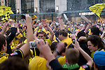 In the ancient marketplace in Dortmund fans celebrated a party because of the title win of their favorite soccer club BVB 09 in the German Premium League. Here they had a beer shower. (The photographer and his gear took the shower too.)