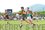 Austin Stacks Denis McElligott gets the better of St Michaels/Foilmore's Brian Galvin and slots this over the bar.