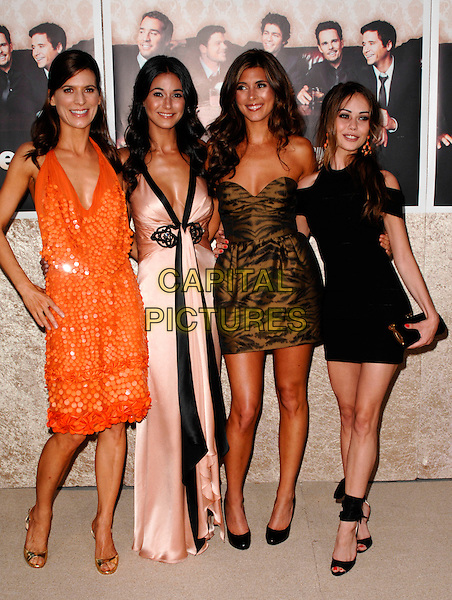 "PERREY REEVES, EMMANUELLE CHRIQUI, JAMIE-LYNN SIGLER & ALEXIS DZIENA.The Los Angeles Premiere of the HBO Original Series ""Entourage"", 6th Season held at Paramount Studios in Hollywood, California, USA. .July 9th, 2009 .full length pink cream silk satin black trim plunging dress orange halterneck hand on hip clutch bag black brown gold strapless zebra animal print pattern  cleavage.CAP/ROT.©Lee Roth/Roth Stock/Capital Pictures"