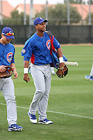 Starlin Castro #13 of the Chicago Cubs arrives on the field during spring training workouts at the Cubs complex on February 19, 2011  in Mesa, Arizona. .Photo by Bill Mitchell / Four Seam Images.