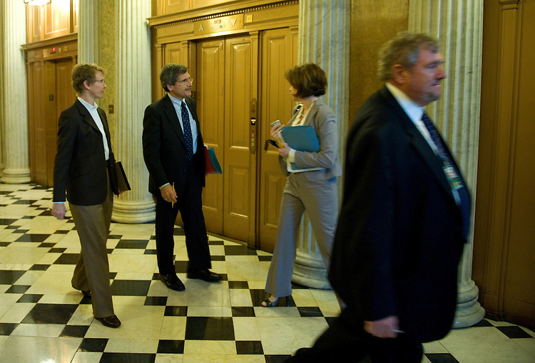 Senate Parliamentarian Alan Frumin (center) talks with staffers outside the LBJ Room just off the House Chamber before a meeting with Democratic and Republican staffers about a way forward on the reconciliation bill.  March 22, 2010.