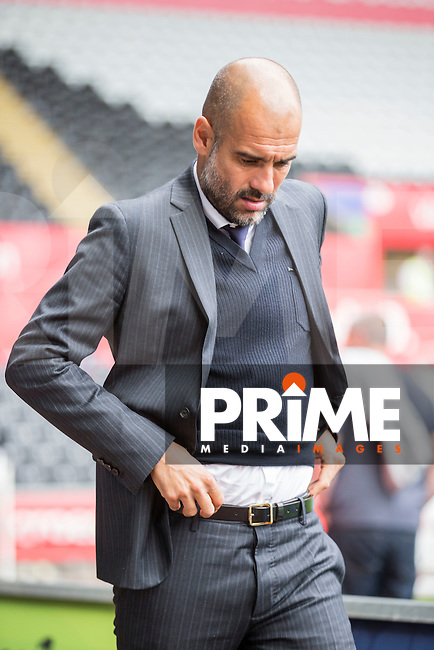 Manchester City manager Pep Guardiola appears to adjust his belt as he arrives at the ground for the EPL - Premier League match between Swansea City and Manchester City at the Liberty Stadium, Swansea, Wales on 24 September 2016. Photo by Mark  Hawkins.