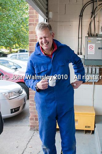 Plumbing student enjoys a hot drink during a break, Able Skills, Dartford, Kent.