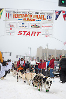 Gerald Sousa and team leave the ceremonial start line at 4th Avenue and D street in downtown Anchorage during the 2013 Iditarod race. Photo by Jim R. Kohl/IditarodPhotos.com