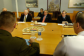 Arlington, VA - May 10, 2007 -- United States President George W. Bush, center, seated between United States Defense Secretary Robert Gates, left, and National Security Adviser Stephen Hadley, at the start of their meeting with the senior defense leaders at the Pentagon, Thursday, May 10, 2007. <br /> Credit: D. Myles Cullen - DoD via CNP