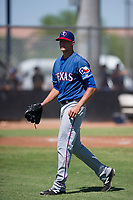 Texas Rangers pitcher Brett Martin (57) walks off the field between innings during an Instructional League game against the San Diego Padres on September 20, 2017 at Peoria Sports Complex in Peoria, Arizona. (Zachary Lucy/Four Seam Images)