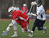 Justin Crowe #7 of Connetquot, left, scoops up a loose ball during a Suffolk County varsity boys lacrosse game against host Huntington High School on Friday, April 7, 2017. Connetquot rallied from a 12-10 deficit early in the fourth quarter to win 15-14.