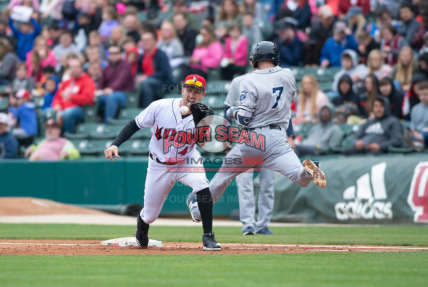 Indianapolis Indians Patrick Kivlehan (47) prepares to catch a throw as Eric Stamets (7) lunges for first base during an International League game against the Columbus Clippers on April 30, 2019 at Victory Field in Indianapolis, Indiana. Columbus defeated Indianapolis 7-6. (Zachary Lucy/Four Seam Images)