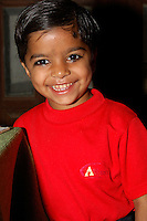 Portrait of smiling young girl in Dundlod, India.