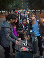 From left, Evita Chavez '15, Caitlyn Lara '15, Shreya Bhaskaran '15 and Emily Rueter '15 make s'mores on the last day of classes. Study break in the Academic Quad, hosted by the ASOC, in which students decorated cookies, made s'mores and had cider and hot chocolate. They could also listen to live music and play games. Dec. 4, 2014 (Photo by Marc Campos, Occidental College Photographer)