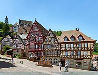 Germany; Bavaria; Lower Franconia; Miltenberg: half-timbered houses at market square with Castle Miltenberg atop (museum) | Deutschland; Bayern; Franken (Unterfranken); Miltenberg: Fachwerkhaeuser am Marktplatz (umgangssprachlich auch 'Schnatterloch' genannt), oberhalb trohnt  die Burg Miltenberg (Museum)