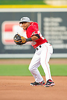 Great Lakes Loons second baseman Jesmuel Valentin (22) makes a throw to first base against the Wisconsin Timber Rattlers at the Dow Diamond on May 4, 2013 in Midland, Michigan.  The Timber Rattlers defeated the Loons 6-4.  (Brian Westerholt/Four Seam Images)