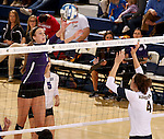 SIOUX FALLS, SD - OCTOBER 14: Jordan Calef #3 from the University of Sioux Falls tips the ball against Becca Finley #4 from Augustana in the second game of their match Tuesday night at the Elmen Center. (Photo by Dave Eggen/Inertia)