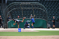 Baltimore Orioles pitcher David Hess delivers a pitch during an informal workout with Major League and Minor League players from around the region on Tuesday, June 2, 2020, at Fluor Field at the West End in Greenville, South Carolina. Los Angeles Dodgers minor leaguer Chase Barbary, who played at Newberry and Spartanburg Methodist, is catching, and Texas Rangers infielder Eli White, who played at Clemson, is hitting. Team workouts have been shut down during the coronavirus pandemic. The players have begun working out in what they call game situation simulations a couple of days a week. (Tom Priddy/Four Seam Images)