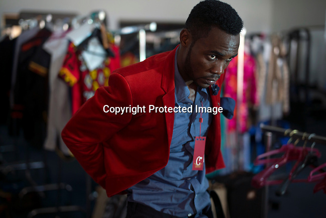 KINSHASA, DRC - JULY 24: A model fits a suit for the South Africa based label Csquared a day before Kinshasa Fashion Week on July 24, 2015, at the boxing gym at Shark club in Kinshasa, DRC. Local and invited foreign-based designers showed their collections during the 2015 edition of Kinshasa Fashion week. (Photo by Per-Anders Pettersson)