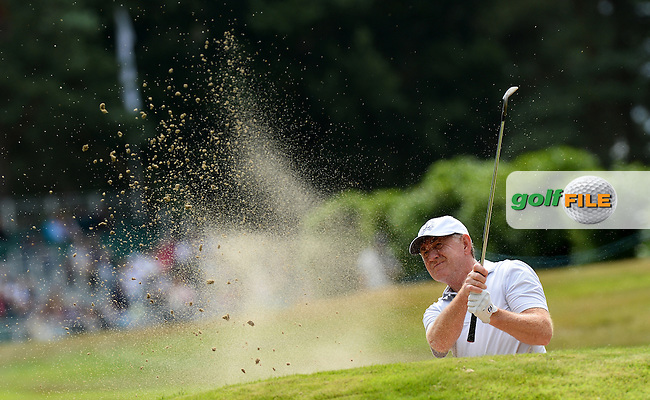 Tony Johnstone of Zimbabwe plays from a bunker during the First Round of The Senior Open at Sunningdale Golf Club, Sunningdale, England. Picture: Golffile   Richard Martin-Roberts<br /> All photo usage must carry mandatory copyright credit (&copy; Golffile   Richard Martin- Roberts)