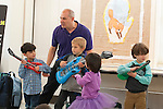 WOODBURY,  CT-122816JS03--Children's entertainer Mr. Joe sings along with children during his Sing, Laugh, and Learn with Mr. Joe program Wednesday at the Woodbury Public Library. The program was made possible through the Friends of the Woodbury Library. <br /> Jim Shannon Republican-American