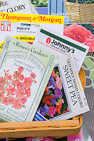 Planting seeds in winter, showing a variety of seed packets from seed companies