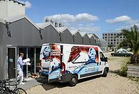 GERMANY, Berlin, Tilapia fish farm of start up ECF, the fish farm is combined with green houses to cultivate vegetables irrigated with sewage water from the fish ponds , the system is called aquaponic, the fish is distributed in Berlin to avoid long transport ways / DEUTSCHLAND, Berlin, Tilapia Fischfarm des start-up Unternehmens ECF auf dem gelaende der ehemaligen Schultheiss Malzfabrik, mit dem naehrstoffhaltigem Abwasser der Fischtanks wird Basilikum im Gewaechshaus bewaessert, Aquaponic System, als Hauptstadt Barsch werden Fisch und Basilikum in Berlin ueber Rewe und Metro lokal vermarket,  Abholung des Fisches durch Metro