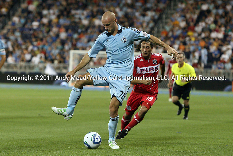 09 June 2011: Kansas City's Aurelien Collin (FRA) (78) and Chicago's Gaston Puerari (URU) (18). Sporting Kansas City played the Chicago Fire to a 0-0 tie in the inaugural game at LIVESTRONG Sporting Park in Kansas City, Kansas in a 2011 regular season Major League Soccer game.