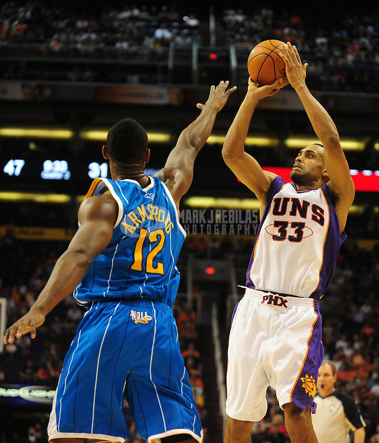 Nov. 11, 2009; Phoenix, AZ, USA; Phoenix Suns forward (33) Grant Hill shoots a three pointer against the New Orleans Hornets at the US Airways Center. Phoenix defeated New Orleans 124-104. Mandatory Credit: Mark J. Rebilas-