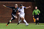 GREENSBORO, NC - DECEMBER 02: Chase Lennartz #19 of North Park University battles Nick West #11 of Messiah College for the ball during the Division III Men's Soccer Championship held at UNC Greensboro Soccer Stadium on December 2, 2017 in Greensboro, North Carolina. Messiah College defeated North Park University 2-1 to win the national title. (Photo by Grant Halverson/NCAA Photos via Getty Images)