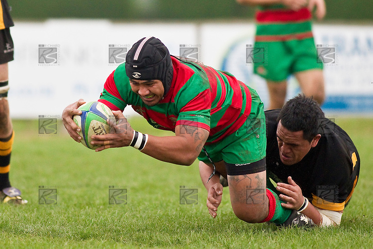 Sosefo Kata dives over in the tackle of Tamapi Akanoa,  to score the first of his two tries. Counties Manukau Premier Club Rugby game between Waiuku and Bombay, played at Waiuku on Saturday July 5th 2010. Waiuku won 59 - 14 after trailing 12 - 14 at halftme.