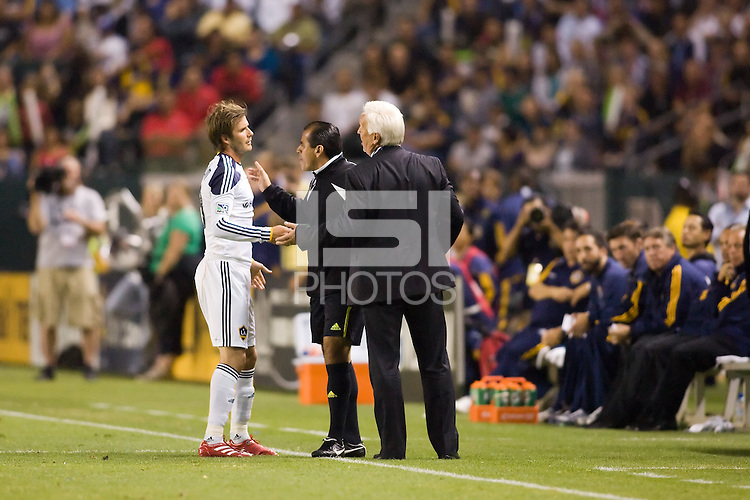 LA Galaxy midfielder David Beckham and New York Red Bulls head coach Hans Backe exchange words. The New York Red Bulls beat the LA Galaxy 2-0 at Home Depot Center stadium in Carson, California on Friday September 24, 2010.