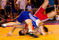 22 MAY 2010 - BIRMINGHAM, GBR - Kiran Matharu (red) v Fiona Robertson (blue) - 2010 English Senior Wrestling Championships .(PHOTO (C) NIGEL FARROW)