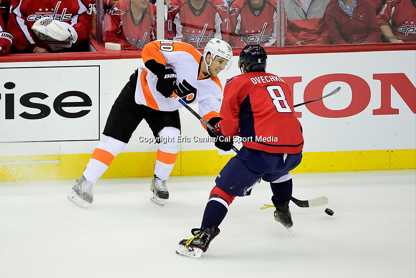 Friday, April 22, 2016: Philadelphia Flyers center Brayden Schenn (10) gets a pass by Washington Capitals left wing Alex Ovechkin (8) during game 5 of the first round of the National Hockey League Eastern Conference playoffs  between the Philadelphia Flyers and the Washington Capitals held at the Verizon Center in Washington, DC. The Flyers defeat the Capitals 2-0. Eric Canha/CSM